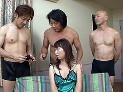Brunette girl is surrounded by three horny studs. They tied up her eyes so she doesn't sees who's dick she is sucking. They changes in turn.