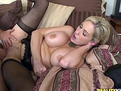 Have fun watching this short haired blonde, with gigantic boobs wearing nylon stockings, while she gets badly screwed over a nice bed.