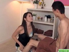 Mature Japanese mom sits on hard cock. She seems to forgot being shy as she gives this young one the hardcore attention he wants from her sexy and soapy body down her hairy cunt.