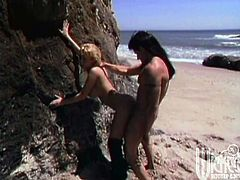 She is so damn sexy and so steaming! Honey gives a nice blowjob to her man and then he dicks her by the rocks! It's so exotic!