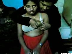 Gross and nasty Indian hooker is absolutely submissive to horny desi. He exposes her tits and squeezes them hard while making an amateur sex video.