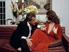 Luxurious brunette in red dress Kay Parker gets eaten