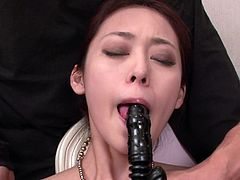 Fabulous Japanese girl with perky tits Ann Yabuki lies on chair wearing stockings and thongs. Multiple guys pet her wet hairy cunt with high powered vibrators.