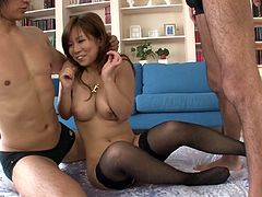 Filthy Japanese harlot Konatsu Aozona gets mouth fucked in MMF threesome