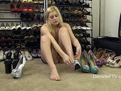 While trying on some new high heels, Danielle pulls up her dress to flash her ass and pussy then drops her top and pulls out her tits.