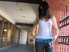 Veronika goes outside after the workout in a gym. She sits down on a bench and pulls pants down. She plays with her pussy and fondles tits.
