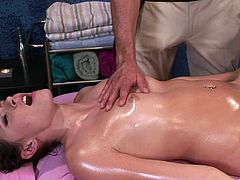 A nasty fuckin' bitch gets oiled up by her masseur who then fuckin' bangs her hard in her stupid-ass pussy. Check it out!