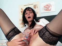 Mature nurse enjoys a big toy cock drilling her cunt during top solo session