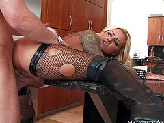 Tattooed busty blonde milf Britney Shannon is his wifes alternate friend with a fierce appetite for fucking. Passionate woman in black stockings and boots takes his rock hard dick in her wet shaved pussy with wild enthusiasm.