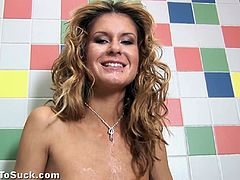 Slim blonde chick takes off her clothes in the bathroom. She gives a blowjob standing on her knees. A guy cums on her tits and in mouth. She also pees in close-up scenes.