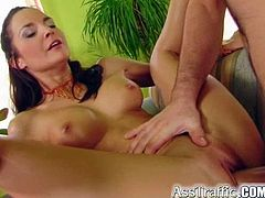Have fun watching this brunette, with a nice ass wearing cute panties, while she hoes hardcore with two horny fellows in a crazy MMF.