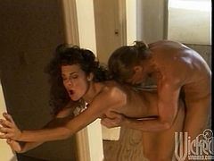 These two are so horny they can't even wait to get into the bedroom. Right in the middle of the hall they fuck and he explodes all over her.