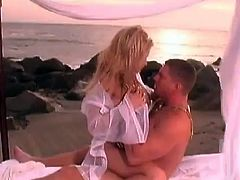 Sweet blonde girl has an amazing sex on a bed on the beach. This magnificent blondie blows a dick and gets fucked in different poses by her beloved.