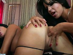 Redhead hooker Jane F. with giant jugs spends her sexual energy with lesbian Angelica Heart