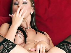 Nikki Rider has fire in her eyes as she plays with herself