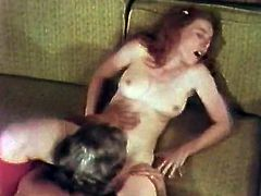 Shapely ginger haired sweetie gets naughty with one nasty guy. Horny babe lies on couch totally naked while dude polishes her tasty coochie with his tongue.