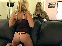 Alison pulls off her thong then spreads her legs on a mirror top table and watches herself as she finger fucks her sweet pussy.