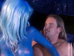 Kinky chick Jessica Drake having blue paint all over her body is getting naughty with some man indoors. She pleases the guy with a blowjob and then takes a fervent ride on his boner.