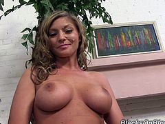 Get wild watching a blonde cougar with gigantic breasts while she chats about having wild sex for a living in a sexy backstage video.