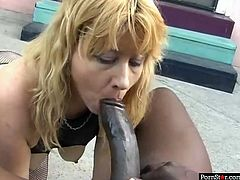 Dumpy blond head old slut drinks cum of African dawg
