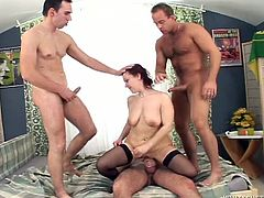 Lustful red haired wench is wearing black nylon stockings filming in hardcore gangbang porn video. Throbbing wet pussy gets fully exploited. Check this out.
