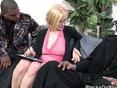 Get a hard dick watching a blonde cougar, with big boobs wearing red lingerie, while she has interracial sex in a crazy threesome.
