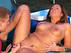 Brown-haired cutie gets fucked doggy style near a tent