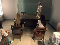 Carmen Hart, Daisy Marie, Hollie Stevens, Lindsey Meadows and McKenzee Miles are trying to please their teacher. They kneel in front of the man in the classroom and suck his boner devotedly.