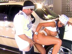 These two preppy gangsters get it on in th eparking garage! She sucks his balls and bends over so he can pound her doggy!
