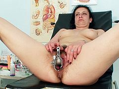 Mature lady with hairy twat gets stretched and stimulated by naughty gyno doctor