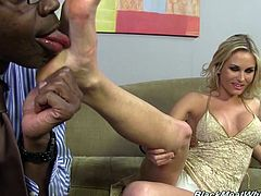 Cute Laura gives this hung, black stud a wicked footjob then she lets him blast his sticky load all over her pretty feet.