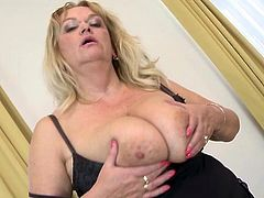 Fat older blonde fondles her big natural tits