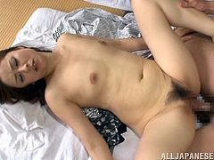 Make sure you see this! A mature Asian, with natural boobs and a very hairy pussy, goes hardcore after a horny guys wakes her up from her sleep.