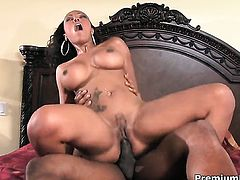 Lacey DuValle with gigantic hooters is extremely horny in this cumshot scene
