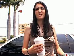 Seductive dark haired whore Eva Uettori goes on a summre break, and gets horny on the car ride and takes off her top to show her nice boobs.