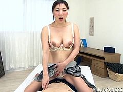 Share this with your friends! Watch an Asian brunette, with huge love pillows wearing a cute bra, while she sucks a big weiner and acts naughty!