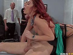 Redhead slut Monique Alexander feels no shame! She takes cock up her pussy and ass right in front of curious co-worker at the office. Public anal sex with what turns her on. She bounces up and down of fat dick until guy shoots his load.