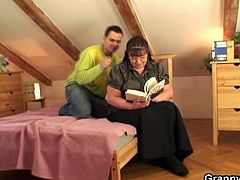 This European granny shows something in a book to a young guy. She ends up with his cock in her hungry mouth and inside her fat cunt. He spoons her and squeezes her boobs.