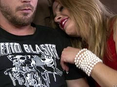 Amanda is Dane's mother in law and she's fucking hot! The mature bitch has some class and she feels attracted by Dane. Amanda wears her red sexy dress and hits on the guy. Soon she reaches her goal and pulls down Dane's pants, to suck his rock hard penis. She sucks it better than her daughter!