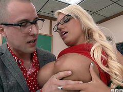 Jacky Joy is a model student. Today she will help the teacher show the class how to properly fuck a woman. She lets the teacher fondle and juggle her massive boobs before she gets down on her knees in the classroom and sucks his penis. Her classmates are stunned.