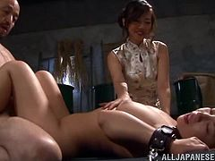 These three sexy japanese babes are locked up in the dungeon and today, one of them is going to be tickled, and fucked my her master and mistress. She is chained to a mattress, then pounded by the man, while the mistress rubs the slaves boobs.