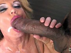 Taylor Wayne is a busty, blonde cougar. She gets nailed in her pretty pussy by a black bloke who dumps his load inside her mouth after he is done with her.