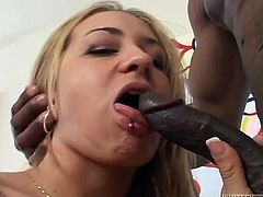 HAve fun with this hot scene where the slutty blonde Trina Michaels sucks on this guy's big cock until her mouth's filled by cum.