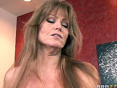 She's a wild one alright, and when it's about fucking milf Darla acts like a crazy slut. This guy knows all that so he films her as she masturbates. The milf then goes straight for his dick, grabs it firmly and puts it all in her mouth. Seems that she unleashed her inner whore and only cum will quench her sex drive!
