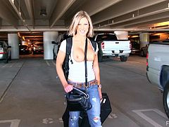 This naughty blonde model arrives to the airport after a vacation. She flashes her tits right there. Anne walks at the parking showing her amazing boobs.