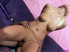 Hot blooded blond slut with nice tits posed missionary style on sofa and got her thirsting kitty banged hard by massive penis of her guy.This cutie is still not enough she starts rubbing her clit with big sex toy.