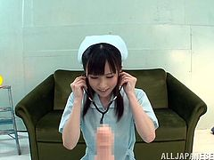 cute asian nurse inspects a cock