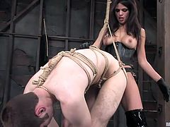 This mistress Shy is wearing nothing but a corset and strapon. She has her slave tied up in rope and she puts that strapon in his mouth and makes him suck it like a good little whore. Then he has to take this fake dick in the ass, too.