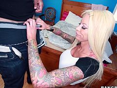 This sexy blonde milf is covered in tattoos so you know she is a dirty lady. She pulls down her leather skirt so you can see her sexy thong. Down go his jeans and her underwear and his big dick is already hard. She wraps her lips around his member and suck him to the edge. She needs some pleasure now so her man is going to eat her out.