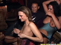 Share this with your friends! Watch these babes, with huge knockers wearing high heels, while they go hardcore together in a wild party.